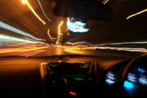 A blurry road from the driver's perspective