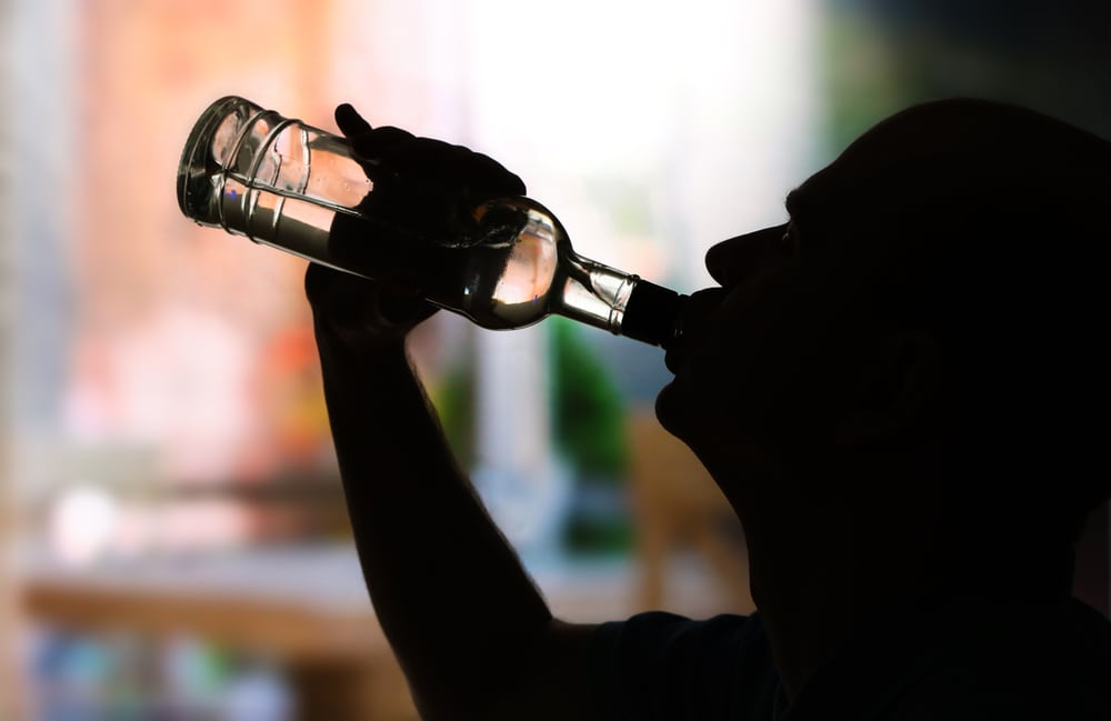man drinking from bottle